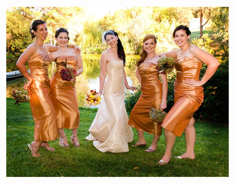 bride and her bridesmaids in orange